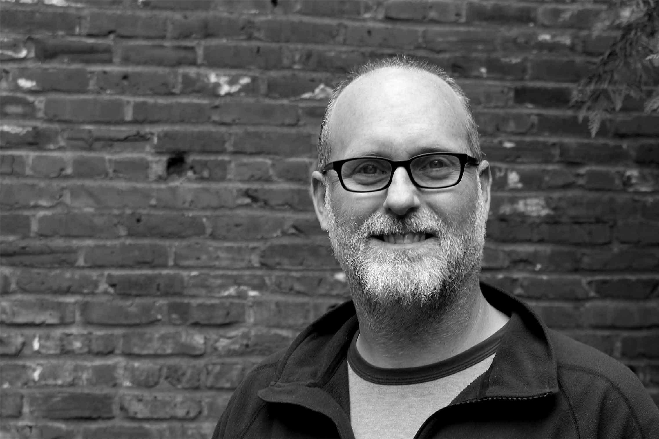Black and white headshot of Andrew Hedges.