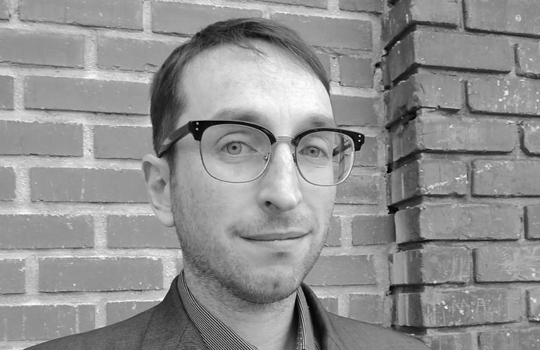 Black and white headshot of David Fine.