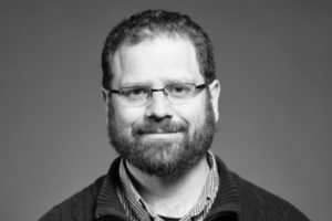 Black and white head shot of Michael DiRoberts.