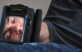 Sleeping man with device surrounding face. Image source:  Sleeping TV Man by Evan is licensed by CC BY-ND 2.0.