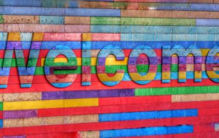 Welcome sign with rainbow colors