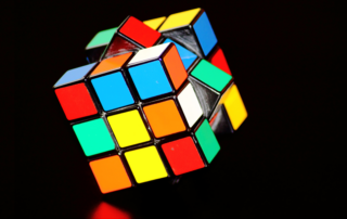 A partially solved Rubik's Cube on a black background.