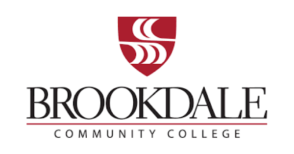Brookdale Community College logo with black lettering on white background & topped with a red shield with abstract white waves in it